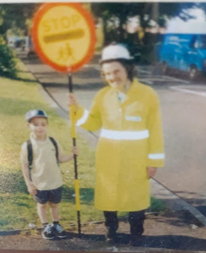 Connie pictured at work as a lollipop lady in Sale. Many Sale families would recognise her when she was off duty too!