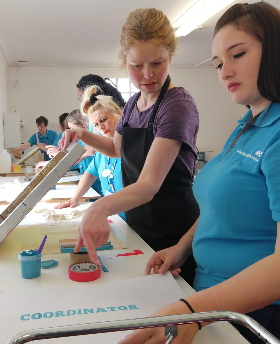 Staff taking part in a previous art workshop. This event was before the current Covid pandemic.